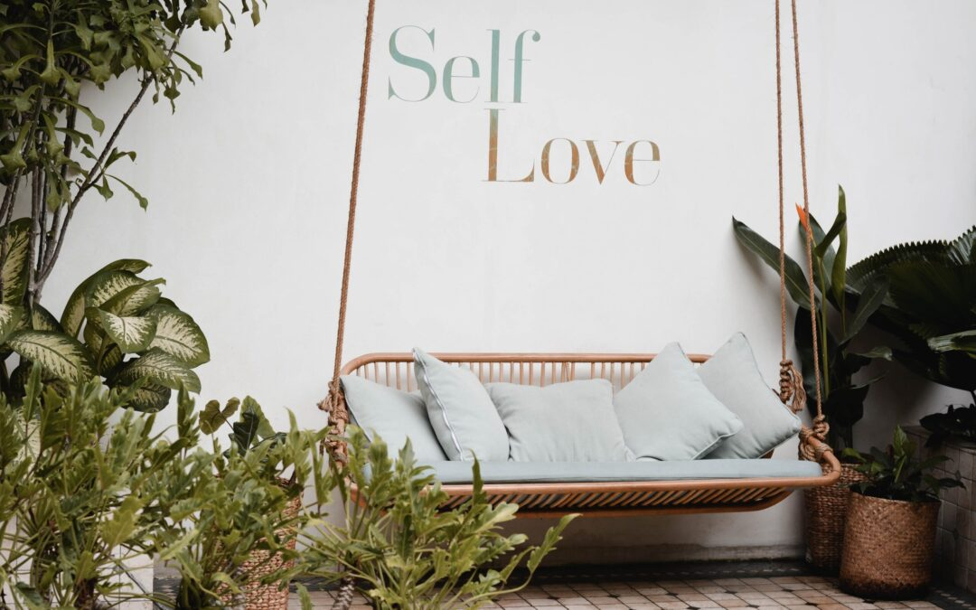brown rattan swing bench with cushions - header for self compassion quotes